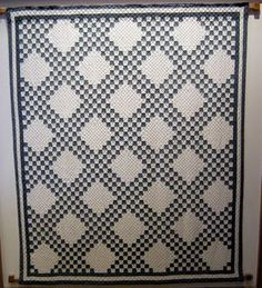 This double Irish chain is one of a collection of 9 antique blue and white quilts.
