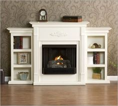 Decent looking for a fake fireplace.- Laura Grimes Evans has a lot of fake/faux fireplace ideas!!!