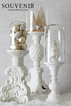 Put globes on candlesticks.  Brilliant!  I have three HUGE candlesticks by my fireplace that this would work on!