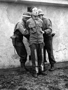Two US MPs prepare German saboteur Gunther Billing for execution, Dec 23, 1944. Billing was part of a German operation during the Ardennes Offensive to spread chaos behind enemy lines by having English-speaking saboteurs, dressed as US troops, spread disinformation and sabotage facilities. Billing was born in the US and spoke native speaker English. He belonged to the paratroopers and operated under the command of Otto Skorzeny, the famed SS special ops operative.