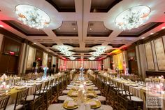 Elegant Indian reception with gold chiavari chairs and rectangular tables via IndianWeddingSite.com
