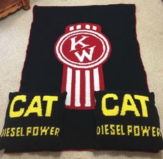 A Kenworth blanket and CAT pillows custom made by Crooked K Creations.