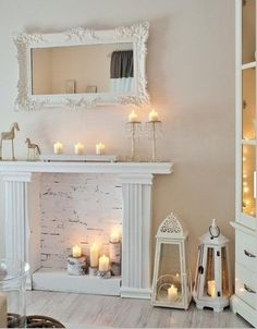 I think I like this idea. Another option for us that don't have a chimney. DIY create a mantel and place lots of candles. Looks amazing!