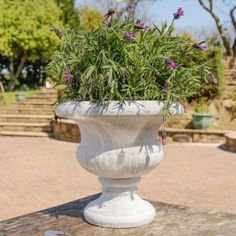 Featuring a traditional antique design this garden planter makes a great addition to a patio or rock garden. In a neutral cream colour with a distressed finish this stylish plant pot is perfect for housing your favourite flowers and plants either in the garden or around the house.