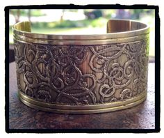 I made this cuff from a brass napkin ring.  Etched bracelet by LjBlock Designs