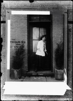 Adele Kennedy: Who Gaily Guides in Greenwich Village. c. 1910s - 1920s. Portrait of Adele Kennedy standing in the doorway of the Treasure Box at 7 Sheridan Square in Greenwich Village.
