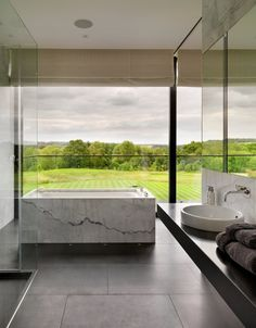 Minimalist Bathroom // Oversized Windows Paired With The Perfect Marble  Soaking Tub Baden, River