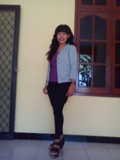 purples shirt and black 12cm high hills :)