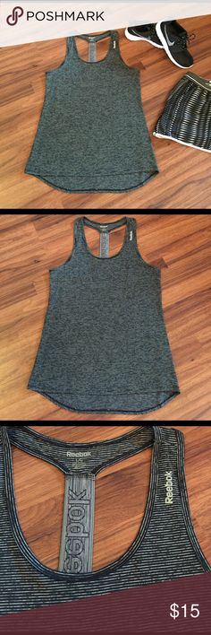 "💥SALE💥Black T Back Reebok Fitted Tank Black T Back Reebok Semi-Fitted Tank. Size Large. In excellent condition and only worn twice. No flaws! Great for working out and running errands!                         Length in front: 28"" Length in Back: 31"" Material: 100% polyester.   💥SALE PRICE IS FIRM💥 Reebok Tops Tank Tops"