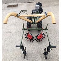 Single row finger weeder on push tractor