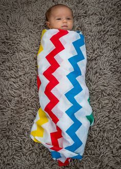 Grace in the rainbow chevron swaddle www.lilcubs.co.uk
