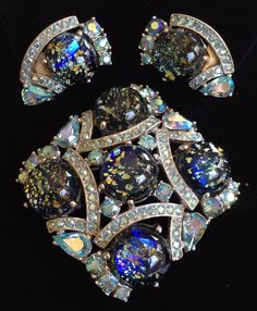 Dazzling Vintage Schiaparelli Brooch Pin & Earrings Set~ Blue Art Glass/ Aurora Borealis Rhinestones/ Silver tone~ Signed by TyTimelessSparkles on Etsy https://www.etsy.com/listing/250984836/dazzling-vintage-schiaparelli-brooch-pin