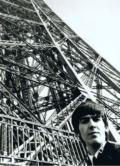 George Harrison at the Eiffel Tower, Paris, 1964. (Scan from The Beatles on the road 1964-1966 by Harry Benson). ☀
