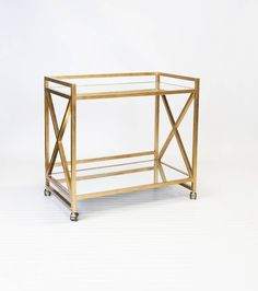 She has it all but will love you forever if you gift her a guilded bar cart! #dominomag #pintowin Gerard Bar Cart in Gold - Worlds Away - $948.00 - domino.com
