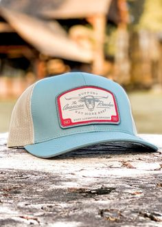 Logo: Embroidered Patch Material: Cotton/poly-twill front panels, Trucker mesh back Closure: Plastic snap adjustable Sizes: Adult | One size fits most Vintage Trucker Hats, Embroidery Materials, Film Aesthetic, Snapback, Cap Ideas, Blue, Embroidered Patch, Mesh, Plastic