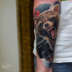 Rocket Raccoon from the Guardians of the Galaxy movie and Marvel comics. Done on guys forearm. Book Tattoo, Arm Tattoo, Sleeve Tattoos, Avengers Tattoo, Marvel Tattoos, Raccoon Tattoo, Rocket Tattoo, Marvel Fan Art, Rocket Raccoon