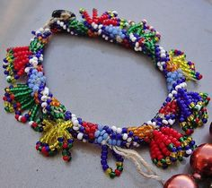 "Bead-work 'bilezik' (bracelet) from the Türkmen villages of the Çölova region (Dinar district, Afyon province).  Part of the traditional women's costumes.  (Source: Tekin Uludoğan, Balıkesir – Note: the owner seems to identify this object as ""Pomak, from the Biga district"", but I do not agree)."