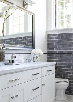 I like the blue stone subway tiles on the far wall. Shower and backsplash in white subway to keep cost down.