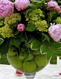 peonies, hydrangea with lime filled vase