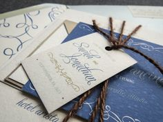 Love this in the cornflower but with lace (to play up your dress) instead of twine.  and maybe accent color it with orange or navy.  Enchanting Vintage Wedding Invitation shown in by JulieHananDesign, $5.95