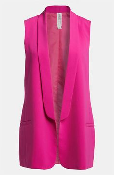 I know I know more pink, but its a sleeveless tux vest how can you not love it? It would be like hating fingerless lace gloves. Not possible.