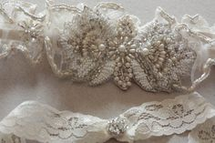 Sheer ivory tulle and lace, delicately beaded with swarovski crystals and pearls.