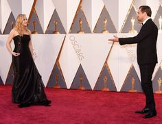 Kate Winslet in Ralph Lauren Collection and Leo DiCaprio in Armani share a moment on the Oscars red carpet in 2016.