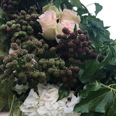An element of the ceremony arch. I love this mixture of delicate roses, hydrangea and blackberries, still unripe. Great work by our florist @robertofiorista  Love Italy, Tiscany and the people there! @castellobanfi_ilborgo #luxurywedding #weddingplanner #