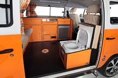 Campervan with seat over toilet, table, kitchen, and use shower outside hooked to roof