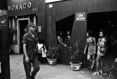 Saigon Bar Girls trying to lure GI's inside into bars.