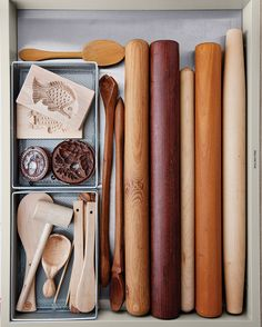 Rolling pins share a drawer with mallets, salad servers, and springerle molds for cookies.
