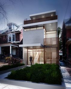 Narrow house visualizes a contemporary house on an urban site.