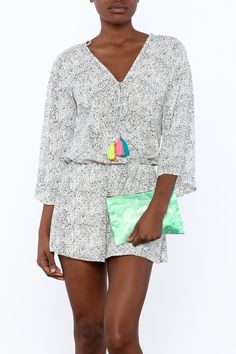 This 3/4 sleeve romper has elastic at the waist, and features bright tassel details at the neckline.   Fun Romper with Tassel by Surf Gypsy. Clothing - Jumpsuits & Rompers - Rompers Arizona