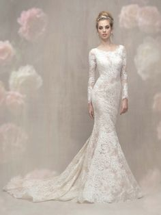 In the light, this beautifully understated lace gown shimmers with a layer of sequins woven throughout.