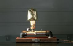 industrial table lamp with a handmade brass lampshade.  http://ateliershuman.com/project/perseus/