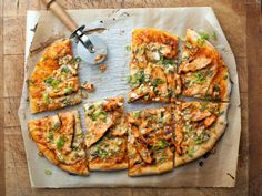Recipe of the Day: Buffalo Chicken Pizza	 Rachael loads store-bought pizza dough with spicy Buffalo chicken, two cheeses and scallions for the ideal slice-and-eat party food.