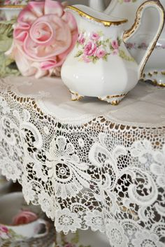 Vintage lace tablecloth--reminds me of my Grandmother.
