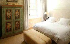 old cupboard + vintage suitcase = master bedroom
