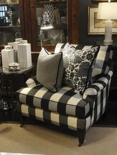 Want to decorate with black and white? Covered in a classic black-and-white buffalo check, this chair is relaxed and timeless, something you could keep for generations.