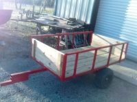 Homemade ATV trailer constructed from square tubing, lumber, and ATV wheels. Trailer Dolly, Power Trailer, Trailer Build, Pull Behind Trailer, Winch Accessories, Homemade Trailer, Atv Winch, Atv Wheels, Diy Kitchen Shelves