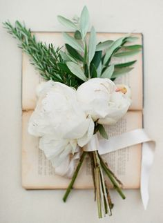 Love this! olive and rosemary sprigs with some ribbon and a big blossom!