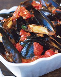 Love mussels in a simple wine sauce steamed in a one large covered pan with tomatoes, onions, celery, squash and peppers over spaghetti with some garlic bread.