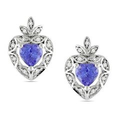 These lovely earrings feature tanzanite centre stones with beautiful accenting smaller diamonds set in 10k white gold. The beautiful earrings are secured with post-with-friction-backs and glimmer with a highly polished finish.