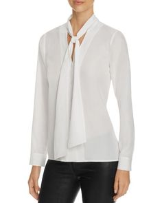 Understated and pulled-together with the femme twist of neck ties, this blouse from Finity is the kind of elegant staple that can transform an entire style routine. | Polyester | Dry clean | Imported