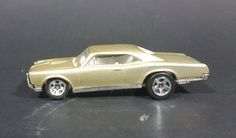 1996 Hot Wheels Pontiac Gold 1967 Pontiac GTO Die Cast Toy Car 1/64 Scale Thailand https://treasurevalleyantiques.com/products/1996-hot-wheels-pontiac-gold-1967-pontiac-gto-die-cast-toy-car-1-64-scale-thailand #1990s #90s #Ninties #HotWheels #1960s #60s #Sixties #Golden #Gold #Pontiac #GTO #Diecast #Toys #Cars #MuscleCars #FastCars #Garage #Mancave #Collectibles #Vehicles #Autos