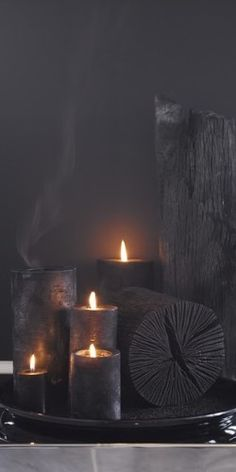 Charcoal on charcoal - the natural air freshener is on the right (no candle) / dark room decor / black candles / moody home decor ideas Candels, Candle Lanterns, Candle Sconces, Decoration Vitrine, Vibeke Design, Candle In The Wind, Decoration Inspiration, Black Candles, Fancy Candles