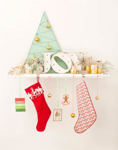 A basic curtain rod is all you need to display multiple stockings and other holiday decor.