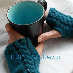 Ravelry: Cabled Cutie Fingerless Mitts pattern by Lindsay English