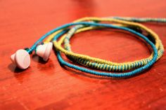 Colorful string and a hair wrap technique around headphones.