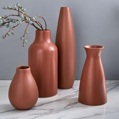 Our hand-thrown Rounded Terracotta Floor Vases come in a mix of shapes, sizes and beautifully unique glazes. They work great as modern accents with a nod to traditional ceramic detailing.